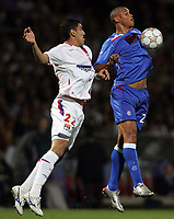 Photo: Paul Thomas.<br /> Lyon v Rangers. UEFA Champions League, Group E. 02/10/2007.<br /> <br /> Daniel Cousins (R) of Rangers wins the ball from Anderson.