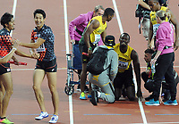 Athletics - 2017 IAAF London World Athletics Championship - Day Thirteen, Evening Session<br /> <br /> Men's 4 x 400m Relay Final<br /> <br /> Usain Bolt of Jamaica grimaces after falling to the ground in the home straight with a leg injury as athletics come to his rescue at the London Stadium.<br /> <br /> COLORSPORT/ANDREW COWIE