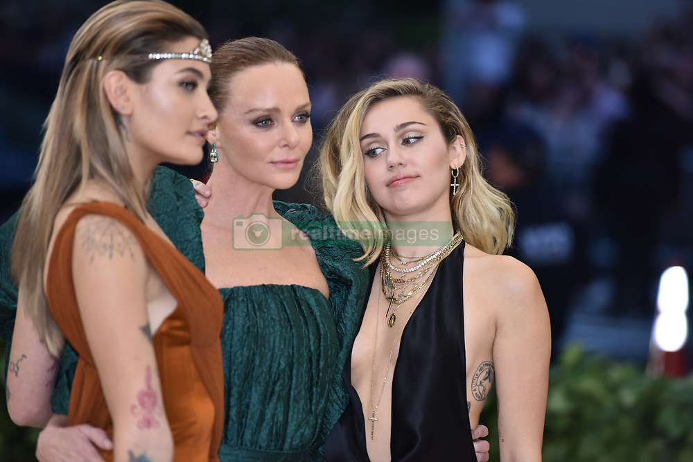 Paris Jackson, Stella McCartney and Miley Cyrus walking the red carpet at The Metropolitan Museum of Art Costume Institute Benefit celebrating the opening of Heavenly Bodies : Fashion and the Catholic Imagination held at The Metropolitan Museum of Art  in New York, NY, on May 7, 2018. (Photo by Anthony Behar/Sipa USA)