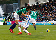 Huddersfield Town's Rajiv van La Parra is bodychecked by West Bromwich Albion's Ahmed El-Sayed Hegazi  during the Premier League match between Huddersfield Town and West Bromwich Albion at the John Smiths Stadium, Huddersfield, England on 4 November 2017. Photo by Paul Thompson.