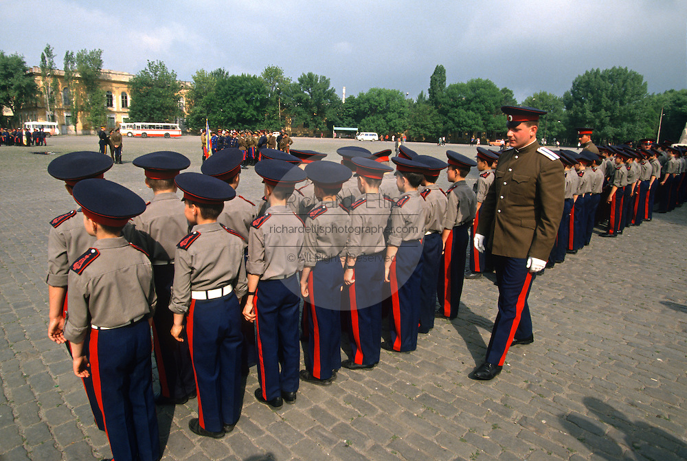 Young Russian Don Cossacks from the Cossack Military School have their uniforms inspected before marching in a parade during the annual Cossack Festival in Novocherkassk, Russia.