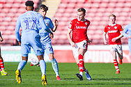 Ryan Hedges of Barnsley (7) passes the ball during the EFL Sky Bet League 1 match between Barnsley and Coventry City at Oakwell, Barnsley, England on 30 March 2019.