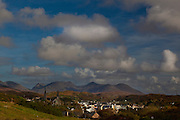 "The town of Clifden, in Connemara, Co. Galway, the ""capital of Connemara"". It's a market town founded in the early 19th century by John D'Arcy. The Twelve Bens, or Pins mountains are in the background."