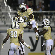 ORLANDO, FL - OCTOBER 09: Jackie Williams #3, Josh Reese #19, William Stanback #28, and Breshad Perriman #11 of the UCF Knights celebrate a touchdown at Bright House Networks Stadium on October 9, 2014 in Orlando, Florida. (Photo by Alex Menendez/Getty Images) *** Local Caption *** Jackie Williams; Josh Reese; William Stanback; Breshad Perriman