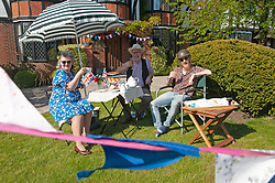 ©Licensed to London News Pictures 08/05/2020  <br /> Pettswood, UK. The O'Donnell family having a garden party in Pettswood, South East London. VE-Day 75th anniversary celebrations in coronavirus lockdown. People enjoy parties in their front gardens with family and neighbours as they observe social distancing. Photo credit:Grant Falvey/LNP
