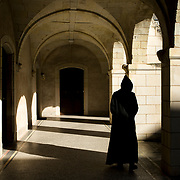 A monk is walking in the priory at Solesmes abbey. 04-05-16<br /> Un moine se promène dans le prieuré de l'abbaye de Solesmes. 04-05-16