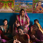 The women of the groom family sing for the bride. Traditional wedding in the Himalaya.