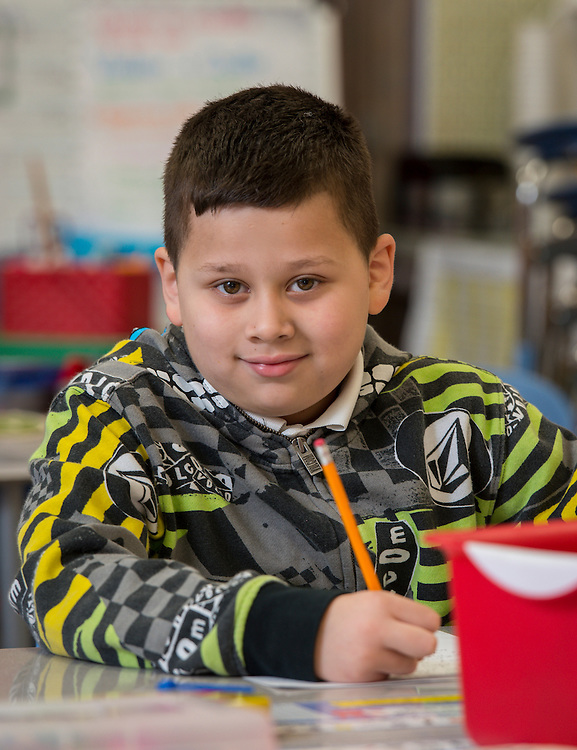Angel Escobar-Larios poses for a photograph at Lantrip Elementary School, February 12, 2015.