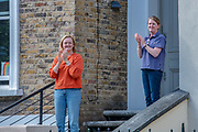 People nearby the house of UK Prime Minister key advisor Dominic Cummings appeared in their doorstep clapping to Salute 72 anniversary of Britain's National Health Service (NHS) in London on Sunday, July 5, 2020. <br /> Prime Minister Boris Johnson's key adviser Dominic Cummings, who has suggested the NHS could provide funding to allow people to select genetic traits such as intelligence for babies is also accused to have flouted lockdown rules that the government had imposed on the rest of the country by driving 250 miles (400 kilometres) to his parents' house while he was falling ill with suspected COVID-19. Cummings or his family members didn't appear in their doorstep to salute NHS 72 anniversary. (VXP Photo/ Erica Dezonne)