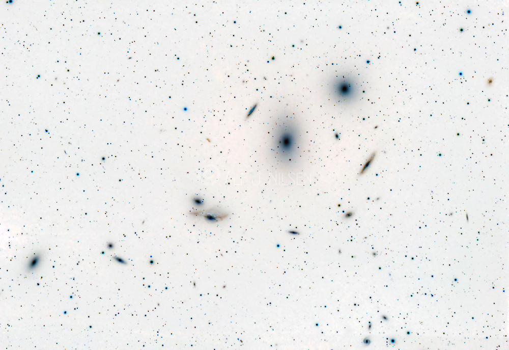 Markarian's Chain, a chain of galaxies forming part of the Virgo Cluster.  The brightest galaxies are the elliptical M84 and M87. Do also see image #73225-D.