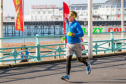 © Licensed to London News Pictures. 02/02/2019. Brighton, UK. Members of the public enjoy a early morning run in the sunshine on the Brighton and Hove promenade. Photo credit: Hugo Michiels/LNP
