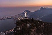 Christ the Redeemer statue at sunset on Corcovado Mountain in Rio de Janeiro, Brazil.