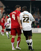 Photo: Mark Stephenson.<br /> Hereford United v Milton Keynes Dons. Coca Cola League 2. 20/10/2007.M K Dons Keith Andrews has words with Hereford's Theo Robinson