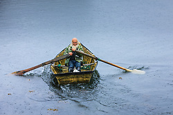 Fisherman rowing out to sea, Kinvarra, County Galway, Ireland
