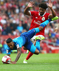 July 29, 2017 - London, United Kingdom - Arsenal's THEO WALCOTT, left, gets tackled by ELISEU of Benfica during an Emirates Cup match at Emirates Stadium. (Credit Image: © Kieran Galvin/NurPhoto via ZUMA Press)