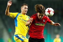 August 3, 2017 - Ljubljana, Slovenia, Slovenia - Caglar Soyuncu of SC Freiburg and Lovro Bizjak of NK Domzale battle for the ball during the UEFA Europa League Third Qualifying Round match between SC Freibur and NK Domzale at Arena Stozice on 3 rd August , 2017 in Ljubljana, Slovenia. (Credit Image: © Damjan Zibert/NurPhoto via ZUMA Press)