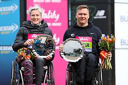Margriet van den Broek winner of the women's wheelchair race and David Weir winner of the men's wheelchair race during the Vitality Big Half in London.