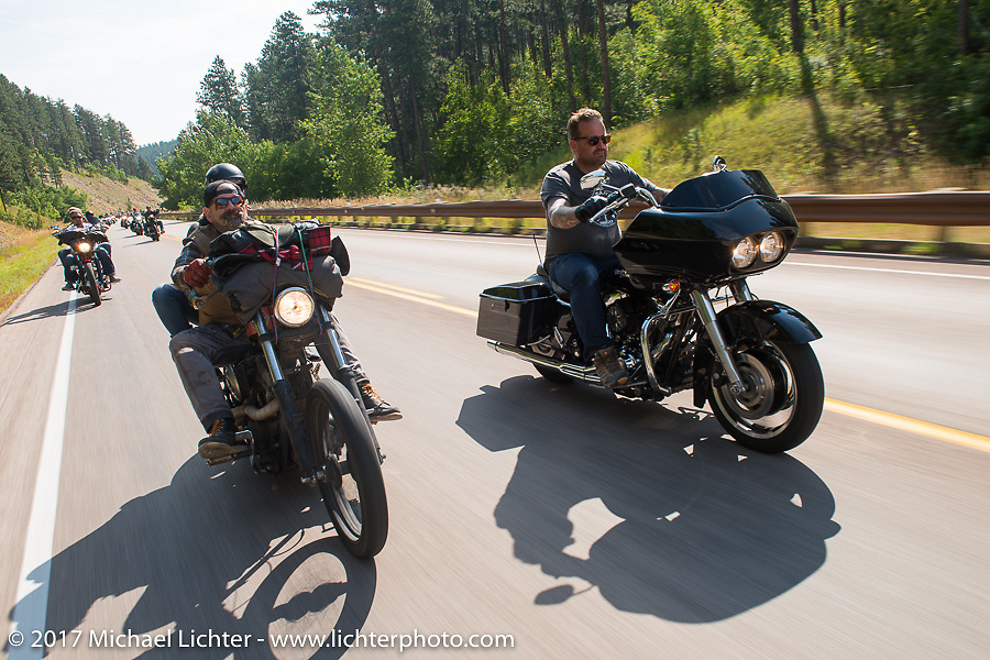 Darrren McKeag and Bobby Seeger Jr on the Bobby Seeger leading Aidan's Ride to raise money for the Aiden Jack Seeger nonprofit foundation to help raise awareness and find a cure for ALD (Adrenoleukodystrophy) during the annual Sturgis Black Hills Motorcycle Rally. Vanocker Canyon between Sturgis and Nemo, SD, USA. Tuesday August 8, 2017. Photography ©2017 Michael Lichter.