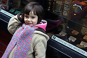 Little girl by a shop in Covent Garden, a major tourist shopping area of central London, on Thursday, Dec. 23, 2004.  **ITALY OUT**