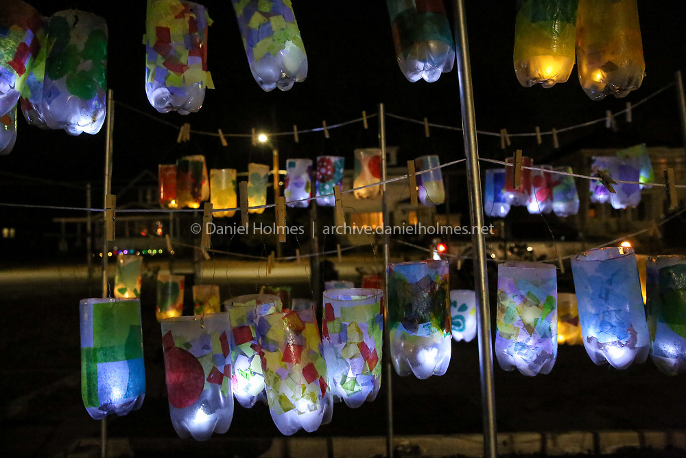 (12/8/18, ASHLAND, MA) Student-made luminaries on display at the Ashland Public Garden during Illuminate Ashland in downtown Ashland on Saturday. Annemarie's Dance Centre, Arts! Ashland Alliance, and the town of Ashland, partnered to highlight the town's thriving arts community.  [Daily News and Wicked Local Photo/Dan Holmes]