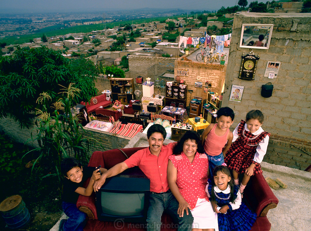 The Castillo Balderas family of Guadalajara, Mexico, outside their home with all of their possessions. Published in Material World: A Global Family Portrait, pages 144-145.