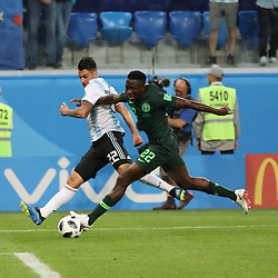 June 26, 2018 - St. Petersburg, Russia - June 26, 2018, Russia, St. Petersburg, FIFA World Cup 2018, First round, Group D, Third round. Football match of Nigeria - Argentina at the stadium of St. Petersburg. Player of the national team Christian Pavon; Kenneth Omeruo. (Credit Image: © Russian Look via ZUMA Wire)