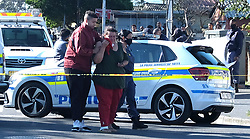 South Africa - Cape Town - 071020.  A distraught Bonita Philander, being led away by a family member from the scene where the  body of her son Tyrone Philander, younger brother of cricketer Vernon Philander, lies after being shot by an unknown gunman in Webner Street, Ravensmead not far from where they live  earlier today while carting water to someone's house.  Picture: Ian Landsberg/African News Agency (ANA).