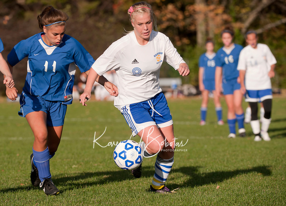 Inter Lake's Marissa Merrill and Gilford's Chelsea Crockett go after the ball during Thursdays NHIAA Division III soccer matchup.  Crockett scored four goals in the first half of play to earn her 100th goal during her high school career.  (Karen Bobotas/for the Laconia Daily Sun)