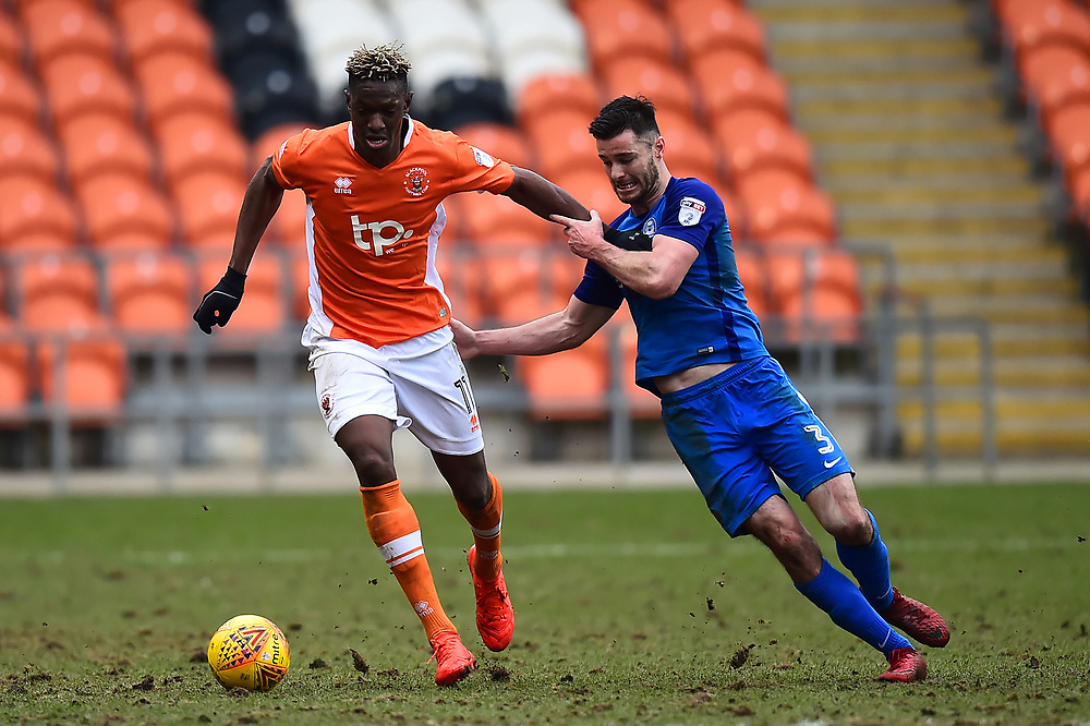 Blackpool's Armand Gnanduillet vies for possession with Peterborough United's Andrew Hughes<br /> <br /> Photographer Richard Martin-Roberts/CameraSport<br /> <br /> The EFL Sky Bet League One - Blackpool v Peterborough United - Sunday 18th February 2018 - Bloomfield Road - Blackpool<br /> <br /> World Copyright © 2018 CameraSport. All rights reserved. 43 Linden Ave. Countesthorpe. Leicester. England. LE8 5PG - Tel: +44 (0) 116 277 4147 - admin@camerasport.com - www.camerasport.com