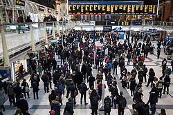 © Licensed to London News Pictures. 27/02/2018. London, UK. Commuters gather in Liverpool Street Station as they attempt to make their way home. Many train services have been cancelled owing to severe weather as the 'Beast from the East' brings freezing Siberian air to the UK. Photo credit: Rob Pinney/LNP