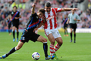Crystal Palace's Joel Ward (l) holds off Stoke city's Jonathan Walters ®.  Barclays Premier league match, Stoke city v Crystal Palace at the Britannia Stadium in Stoke on Trent on Saturday 24th August 2013. pic by Andrew Orchard , Andrew Orchard sports photography,