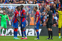 Football - 2021/2022  Premier League - Crystal Palace vs Brentford - Selhurst Park  - Saturday 21st August 2021.<br /> <br /> A frustrated Wilfried Zaha (Crystal Palace) is held back by Cheikhou Kouyate (Crystal Palace) as he tries to confront referee Martin Atkinson at Selhurst Park.<br /> <br /> COLORSPORT/DANIEL BEARHAM