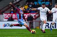 George Thomas of Scunthorpe United (18) shoots during the EFL Sky Bet League 1 match between Scunthorpe United and Coventry City at Glanford Park, Scunthorpe, England on 5 January 2019.