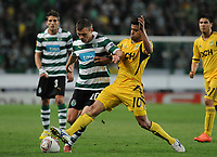 20120329: LISBON, PORTUGAL - Football - UEFA Europe League 2011/2012 - Quarter-finals, First leg: Sporting CP vs Metalist<br />In picture: Sporting's Marat Izmailov, from Russia, left, fights for the ball with Metalist's Cleiton Xavier, from Brazil.<br />PHOTO: Alvaro Isidoro/CITYFILES