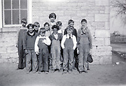 female teacher posing with an all boys class USA 1920s