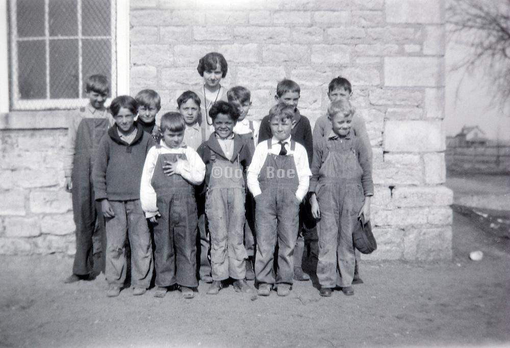female teacher posing with an all boys class USA 1920s