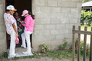 Health workers carry out a house-to-house survey to make sure children were vaccinated in San Esteban, Honduras on Thursday April 25, 2013.