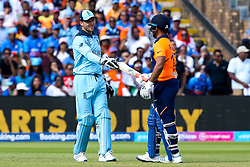 Jos Buttler of England gives Rishabh Pant of India his <br /> bat back - Mandatory by-line: Robbie Stephenson/JMP - 30/06/2019 - CRICKET - Edgbaston - Birmingham, England - England v India - ICC Cricket World Cup 2019 - Group Stage