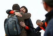 A Russian passenger is hugged by a colleague after disembarking from the Russian-chartered ferry Sveti Stefan II after it arrived with some 400 East European evacuees from Ras Lanuf in Libya at Valletta's Grand Harbour March 2, 2011.  Some 13,000 people have been evacuated from Libya to Malta since the crisis broke out, according to local officials..REUTERS/Darrin Zammit Lupi (MALTA)