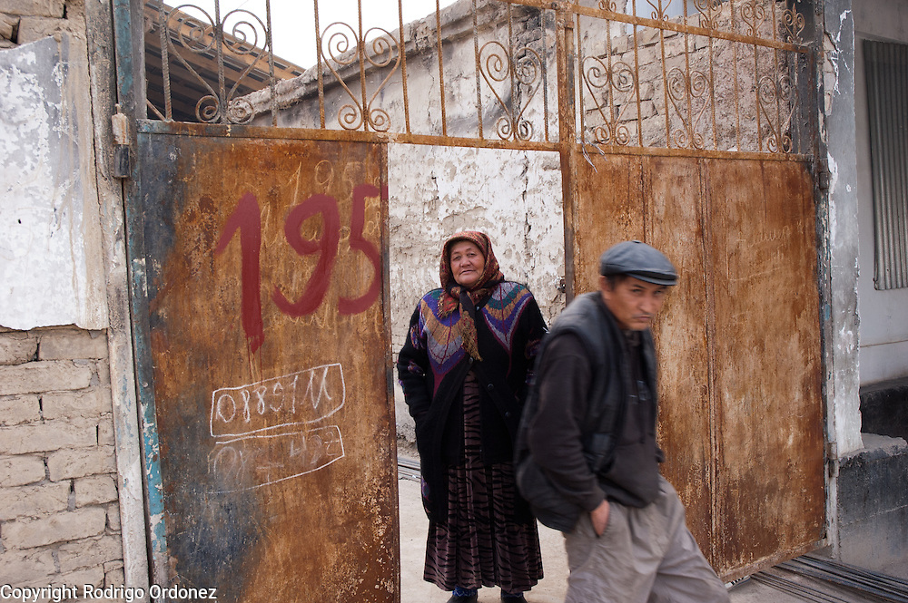 Matlubahan Umarjanova (left), 60, and a relative leave her family's home in Osh (Kyrgyzstan). With equipment and materials provided by Save the Children, she reopened her business, a kiosk selling groceries and common household items.