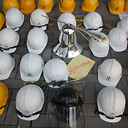 Hard hats left outside the Central Government Offices by the Umbrella Movement. The hats are a symbol of a political struggle and were used in occupying the streets of Hong Kong earlier in the year. The movement demands universal suffrage in Hong Kong with direct elections of the Chief Executive.