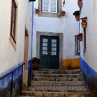 Europe, Portugal, Obidos. Romantic cobbled walkway of Obidos.