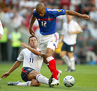 England v France - Estadio de Luz, Lisbon - 13th June 2004<br />England's Frank Lampard nips the ball away from France's Thierry Henry<br />Photo: Jed Leicester/Sporting Pictures<br />© Sporting Pictures (UK) Ltd<br />www.sportingpictures.com<br />Tel: +44 (0)20 7405 4500<br />Fax: +44 (0)20 7831 7991