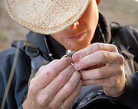Travis Goodman of Wilson ties a fly before heading out to fish Flat Creek on Sunday morning. The trout in the creek are known to be finicky, and some anglers claim they can sense the footfalls of approaching fisherman.