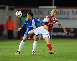Peterborough United's Nicky Ajose is challenged by Bristol City's Simon Gillett - Photo mandatory by-line: Dougie Allward/JMP - Mobile: 07966 386802 11/03/2014 - SPORT - FOOTBALL - Peterborough - London Road Stadium - Peterborough United v Bristol City - Sky Bet League One