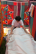 On Site massage at a festival a woman in her 40s receiving an oil massage