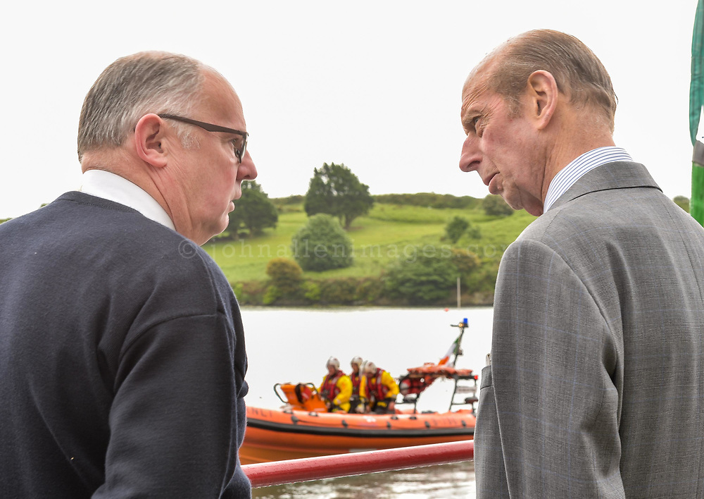 """REPRO FREE<br /> His Royal Highness the Duke of Kent talks to John O'Gorman, Lifeboat Operations Manager Kinsale RNLI while the lifeboat launches on a drill during a visit to Kinsale RNLI Lifeboat Station on Wednesday.<br /> Picture. John Allen<br /> <br /> Volunteer crew members of Kinsale RNLI  gave a warm welcome the His Royal Highness the Duke of Kent who made his first visit to the busy West Cork lifeboat station today (Wednesday 31 May).  The Duke has been Patron and President  of the RNLI,  the charity that saves lives at sea, since 1969.   He spent almost an hour meeting volunteers and hearing details of successful rescues by the Kinsale volunteers, including the Sean Anthony in April 2016 when three Portuguese fishermen were saved from a sinking trawler, and the evacuation of 30 people from the sailing vessel Astrid that foundered outside Kinsale Harbour in July 2013.  The Duke was introduced to Christopher Keane Hopcraft, one of the young people rescued from the Astrid, and Mrs Janet Rutherford who received medical attention and was brought to safety after she was injured on board a yacht.  Members of the local community were also invited to meet the Duke, including representatives of Kinsale's fishing fleet, along with RNLI volunteers from West Cork's newest station in Union Hall and representatives of the GAA, partners in the RNLI Respect the Water campaign that aims to halve the number of coastal deaths by 2024.<br /> <br /> The Duke said:<br /> <br /> Kinsale RNLI Lifeboat Operations Manager, John O'Gorman, said:  """"It was a honour and a privilege for us to meet the Duke who has provided unwavering support to the RNLI for almost half a century.  Our station on the Wild Atlantic Way is a long way from the RNLI HQ in Poole so we rarely get the opportunity to meet someone so close to the heart of the charity.  In that time he has visited the vast majority of lifeboat stations and we are delighted he chose to add Kinsale to that list.  He showed a great kno"""