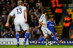 Chelsea Defender Ashley Cole (ENG) is challenged by Basel Defender Kay Voser (SUI) during the first half of the match - Photo mandatory by-line: Rogan Thomson/JMP - Tel: 07966 386802 - 18/09/2013 - SPORT - FOOTBALL - Stamford Bridge, London - Chelsea v FC Basel - UEFA Champions League Group E