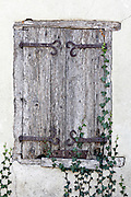 old weathered wooden window shutters