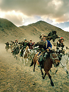 "The ""Berkuchis"", the eagle hunters, are parading during the official start-off of the festival.<br /> <br /> Eagle Hunting festival in Western Mongolia, in the province of Bayan Olgii. Mongolian and Kazak eagle hunters come to compete for 2 days at this yearly gathering. Mongolia"